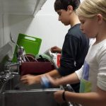 Children doing dishes at Caulbridge School