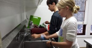 Children doing dishes at Caulbridge School