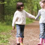 Girls holding hands at Caulbridge School