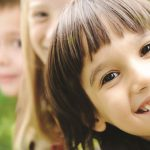Close-up of happy children at Caulbridge School